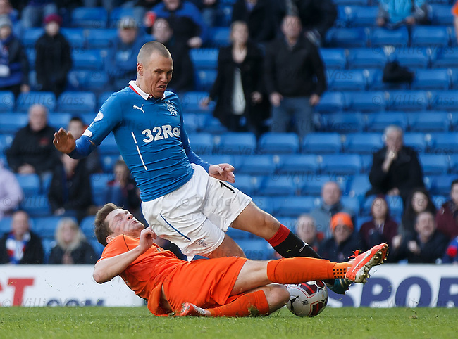 Ross Barbour tackles Kenny Miller in the box