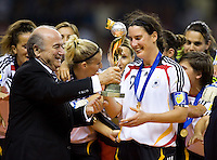 German captain (9) Birgit Prinz accepts the Women's World Cup Trophy from FIFA President Joseph S. Blatter after the FIFA Women's World Cup final at Hongkou Stadium in Shanghai, China on September 30, 2007.  Germany defeated Brazil, 2-0.