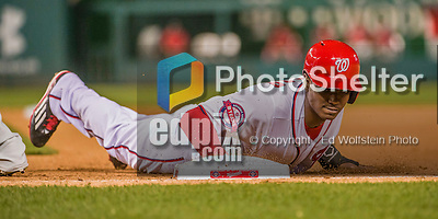 22 May 2015: Washington Nationals outfielder Michael Taylor dives safely back to first during game action against the Philadelphia Phillies at Nationals Park in Washington, DC. The Nationals defeated the Phillies 2-1 in the first game of their 3-game weekend series. Mandatory Credit: Ed Wolfstein Photo *** RAW (NEF) Image File Available ***