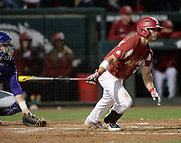 NWA Democrat-Gazette/ANDY SHUPE<br /> Arkansas center fielder Dominic Fletcher hits an RBI single Friday, May 10, 2019, during the seventh inning against LSU at Baum-Walker Stadium in Fayetteville. Visit nwadg.com/photos to see more photographs from the game.