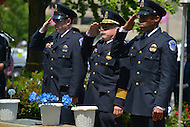 May 10, 2013  (Washington, DC)  U.S. Capitol Police Chief Kim Dine (c) and Capitol Police officers salute after dedicating flowers during a ceremony at the Washington Area Law Enforcement Memorial.  (Photo by Don Baxter/Media Images International)