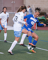 Chicago Red Stars defender Lydia Vandenbergh (13) and Boston Breakers forward Lianne Sanderson (10) compete for the ball.  In a National Women's Soccer League Elite (NWSL) match, the Boston Breakers defeated  Chicago Red Stars 4-1, at the Dilboy Stadium on May 4, 2013.
