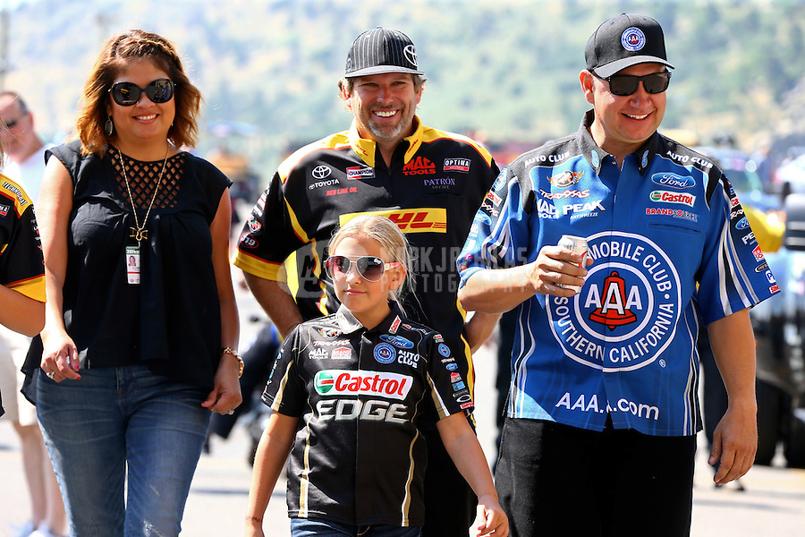 Jul. 20, 2014; Morrison, CO, USA; NHRA funny car driver Robert Hight (right) with daughter Autumn Hight and Del Worsham and wife Connie Worsham during the Mile High Nationals at Bandimere Speedway. Mandatory Credit: Mark J. Rebilas-