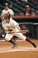 Arizona State second baseman Eric Sogard (28) lays down a bunt versus Texas A&M at the 2007 Houston College Classic at Minute Maid Park in Houston, TX, Friday, February 9, 2007.  Arizona State defeated Texas A&M 5-4.