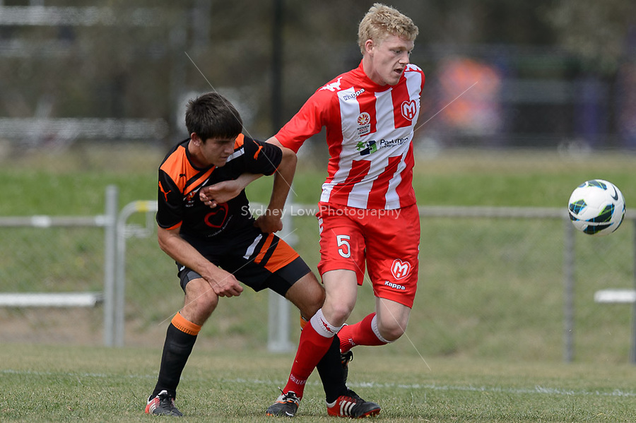 MELBOURNE - 3 NOV: William ABBOTT of the Heart protects the ball from Cameron CRESTANI of the Roar in the round three National Youth League match between Melbourne Heart and Brisbane Roar at John Cain Reserve on 3 November 2012. (Photo Sydney Low/syd-low.com/Melbourne Heart)