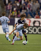 Colorado Rapids midfielder Wells Thompson (15) attempts to control the ball as New England Revolution defender Kevin Alston (30) defends. The Colorado Rapids defeated the New England Revolution, 2-1, at Gillette Stadium on April 24, 2010.