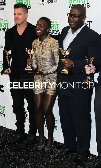 SANTA MONICA, CA, USA - MARCH 01: Brad Pitt, Lupita Nyong'o, Steve McQueen in the press room during the 2014 Film Independent Spirit Awards held at Santa Monica Beach on March 1, 2014 in Santa Monica, California, United States. (Photo by Xavier Collin/Celebrity Monitor)