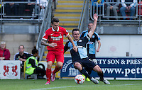 Matt Bloomfield of Wycombe Wanderers & Dean Cox of Leyton Orient battle for the ball during the Sky Bet League 2 match between Leyton Orient and Wycombe Wanderers at the Matchroom Stadium, London, England on 19 September 2015. Photo by Andy Rowland.