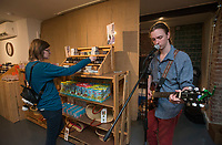 NWA Democrat-Gazette/BEN GOFF @NWABENGOFF<br /> Ash Spitzer of Bentonville shops as Mike Kinkle of Rogers plays music Thursday, Nov. 9, 2017, at Serenity Naturals, a new natural skincare and bath products business which opened today, during the first Art on the Bricks event in downtown Rogers. More than 20 downtown Rogers businesses participated in the walk, hosting pop-up galleries, artist receptions and live music in what is planned as a regular event on the second Thursday of each month from 4:30p.m. to 6:30p.m.