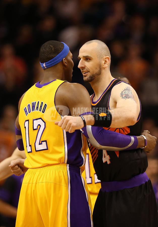 Jan. 30, 2013; Phoenix, AZ, USA: Los Angeles Lakers center Dwight Howard (12) greets Phoenix Suns center Marcin Gortat (4) at the US Airways Center. Mandatory Credit: Mark J. Rebilas-
