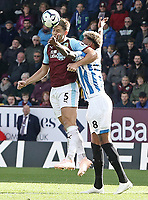Burnley's James Tarkowski out-jumps Huddersfield Town's Philip Billing to win a header<br /> <br /> Photographer Rich Linley/CameraSport<br /> <br /> The Premier League - Burnley v Huddersfield Town - Saturday 6th October 2018 - Turf Moor - Burnley<br /> <br /> World Copyright &copy; 2018 CameraSport. All rights reserved. 43 Linden Ave. Countesthorpe. Leicester. England. LE8 5PG - Tel: +44 (0) 116 277 4147 - admin@camerasport.com - www.camerasport.com