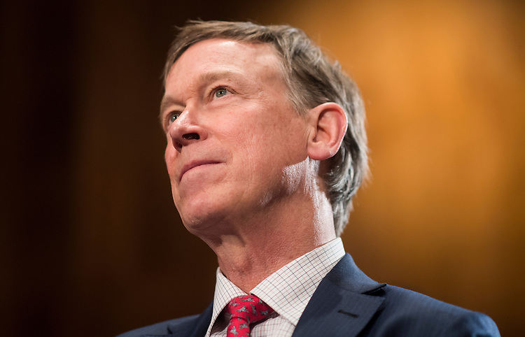 UNITED STATES - FEBRUARY 27: Gov. John Hickenlooper, D-Colo., listens as Gov. Terry McAuliffe, D-Va., speaks to the press in the Dirksen Senate Office Building on Monday, Feb. 27, 2017. (Photo By Bill Clark/CQ Roll Call)