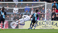 Goalkeeper Ryan Allsop (Loanee from Bournemouth) of Wycombe Wanderers pulls off a save during the Sky Bet League 2 match between Wycombe Wanderers and Barnet at Adams Park, High Wycombe, England on 16 April 2016. Photo by Andy Rowland.