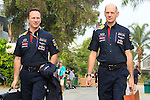 KUALA LUMPUR, MALAYSIA - MARCH 28: Redbull Racing Team Principle Christian Horner of Great Britain arrives at the paddock with Chief Technical Officer Adrian Newey of Great Britain ahead of the first practice session during the Malaysia Formula One Grand Prix at the Sepang Circuit on March 28, 2014 in Kuala Lumpur, Malaysia. (Photo by PETER LIM/PhotoDesk.com.my)