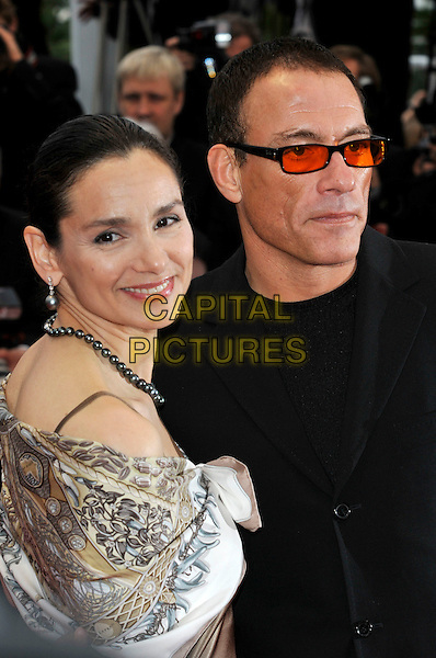 GLADYS PORTUGUES, JEAN-CLAUDE VAN DAMME.Attending the screening of 'You Will Meet a Tall Dark Stranger' presented out of competition at the 63rd Cannes Film Festival, Cannes, France, .15th May 2010..premiere portrait headshot  couple married husband wife tinted orange lenses glasses silver black suit necklace grey gray pearls print smiling .CAP/PL.©Phil Loftus/Capital Pictures.