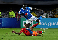 BOGOTA - COLOMBIA - 11 - 03 - 2017: Deiver Machado (Der.) jugador de Millonarios disputa el balón con Jhonny Vasquez (Izq.) jugador de America, durante partido de la fecha 9 entre Millonarios y America de Cali, por la Liga Aguila I-2017, jugado en el estadio Nemesio Camacho El Campin de la ciudad de Bogota. / Deiver Machado (R) player of Millonarios vies for the ball with Jhonny Vasquez (L) player of America, during a match between Millonarios and America de Cali, of the date 9 for the Liga Aguila I-2017 played at the Nemesio Camacho El Campin Stadium in Bogota city, Photo: VizzorImage / Luis Ramirez / Staff.