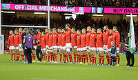 Pictured: The Wales squad sing their national anthem Sunday 20 September 2015<br />