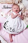 Baby girl Makena only 14 days old posing for an easter picture infant cute cuddly