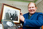 Fianna Fail TD John O'Leary Killarney points to a picture of himself and his old leader Charlie Haughey which will be in the book about his memoirs On The Doorsteps next month