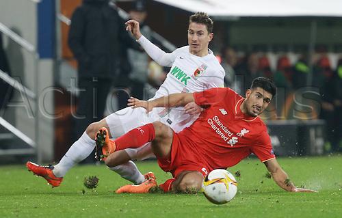 18.02.2016. Augsburg, Germany. UEFA Europa League football. Augsburg versus Liverpool FC.  Paul Verhaegh ( Augs ) clattered by Emre Can ( Liverpool )