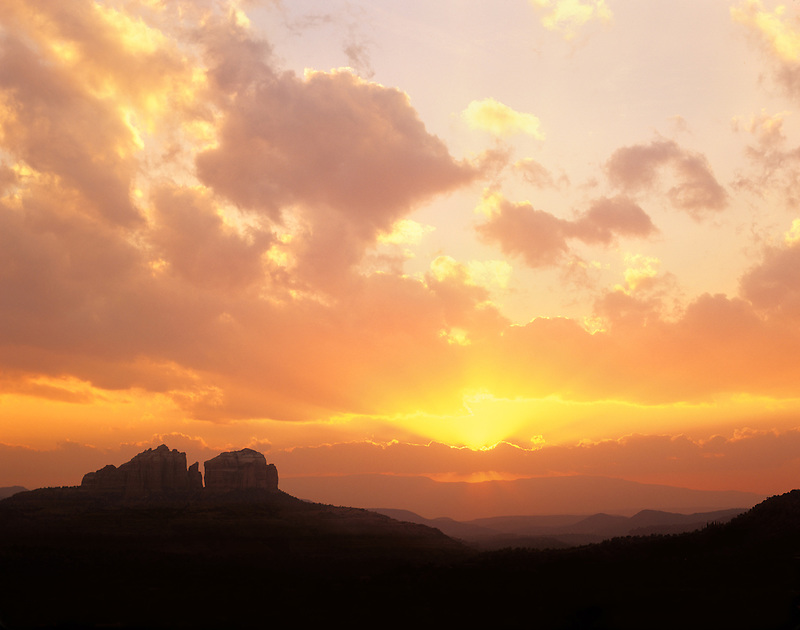Sunset clouds with sun rays. Near Sedona, Arizona.
