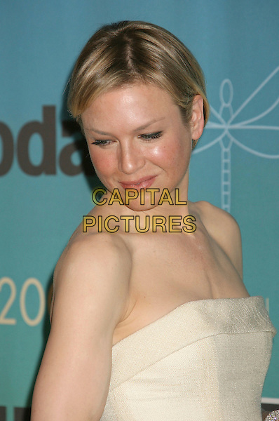 RENEE ZELLWEGER.2007 Crystal and Lucy Awards held at the Beverly Hilton Hotel, Beverly Hills, California ,USA,14 June 2007.portrait headshot looking down strapless.CAP/ADM/RE.©Russ Elliot/AdMedia/Capital Pictures.