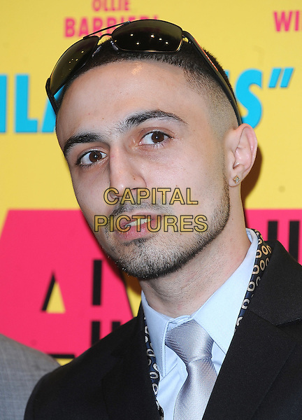 "ADAM DEACON .attending the UK Premiere of ""Anuvahood"", Empire cinema, Leicester Square, London, England, UK, .15th March 2011.portrait headshot sunglasses on head silver tie black  beard facial hair .CAP/BEL.©Tom Belcher/Capital Pictures."