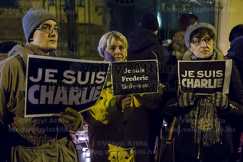 Participants show their support for the terrorist attack victim staff of the Charlie Hebdo satirical weekly in front of the French Embassy in Budapest, Hungary on January 09, 2015. ATTILA VOLGYI