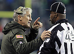 Seattle Seahawks  head coach Pete Carroll questions Field Judge Terry Brown about a penalty called against the Seahawks in their game against the Arizona Cardinals at CenturyLink Field in Seattle, Washington on November 15, 2015. The Cardinals beat the Seahawks 39-32.   ©2015. Jim Bryant photo. All Rights Reserved.