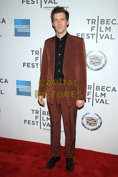 "Daryl Wein (Director).The 2012 Tribeca Film Festival World Premiere of ""Lola Versus"" at the Tribeca Performing Arts Center, New York, NY, USA..April 24th, 2012.full length black shirt brown suit.CAP/LNC/TOM.©LNC/Capital Pictures."