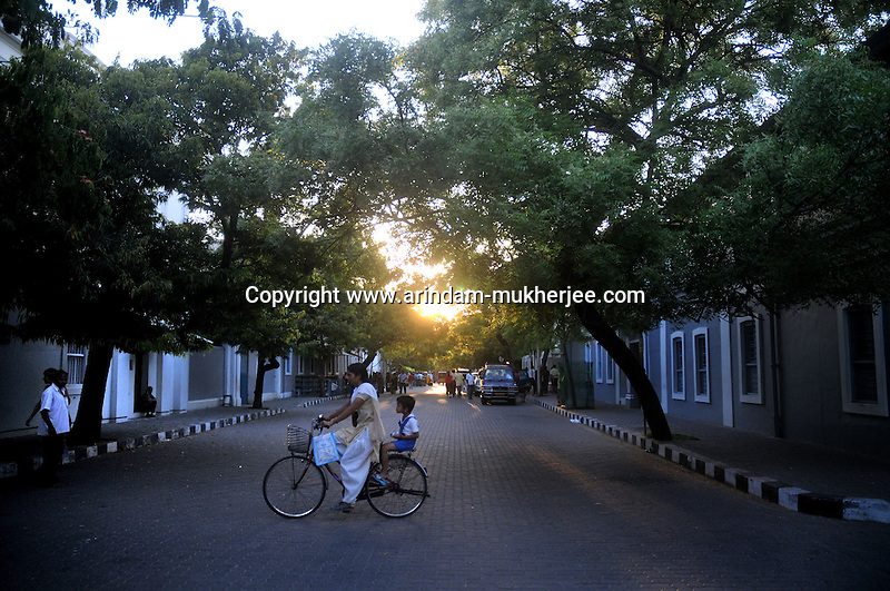 A lady rides a bycycle with her son near Aurobindo Asram. Bycycle is a very popular coviance in the French colony in Pondicherry. Arindam Mukherjee/Sipa