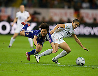 Carli Lloyd (10) of the United States collides with Shinobu Ohno (11) of Japan during the final of the FIFA Women's World Cup at FIFA Women's World Cup Stadium in Frankfurt Germany.  Japan won the FIFA Women's World Cup on penalty kicks after tying the United States, 2-2, in extra time.