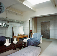 The living room area was converted from a butcher's shop and still has the original wall tiles and barrel ceiling. The use of various shades of grey and blue soften the industrial feel of the room