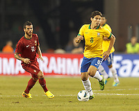 Brazil substitute midfielder Hernanes (8) dribbles at midfield.  In an international friendly, Brazil (yellow/blue) defeated Portugal (red), 3-1, at Gillette Stadium on September 10, 2013.