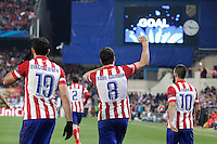 Atletico de Madrid´s Raul Garcia celebrates a goal with Diego Costa and Arda Turan during 16th Champions League soccer match at Vicente Calderon stadium in Madrid, Spain. March 11, 2014. (ALTERPHOTOS/Victor Blanco)
