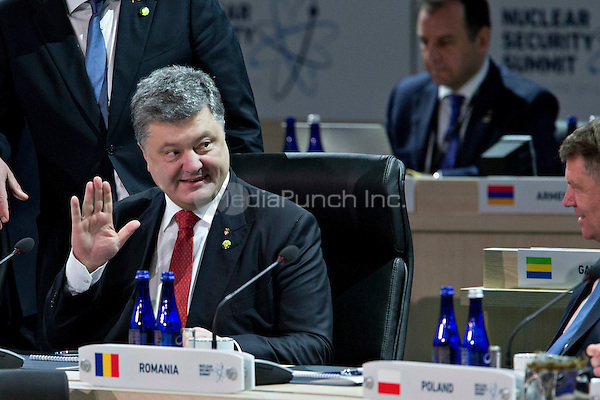 Petro Poroshenko, Ukraine's president, waves during an opening plenary entitled &quot;National Actions to Enhance Nuclear Security&quot; at the Nuclear Security Summit in Washington, D.C., U.S., on Friday, April 1, 2016. After a spate of terrorist attacks from Europe to Africa, U.S. President Barack Obama is rallying international support during the summit for an effort to keep Islamic State and similar groups from obtaining nuclear material and other weapons of mass destruction. <br /> Credit: Andrew Harrer / Pool via CNP/MediaPunch