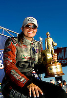 Sept. 6, 2010; Clermont, IN, USA; NHRA funny car driver Ashley Force Hood celebrates after winning the U.S. Nationals at O'Reilly Raceway Park at Indianapolis. Mandatory Credit: Mark J. Rebilas-