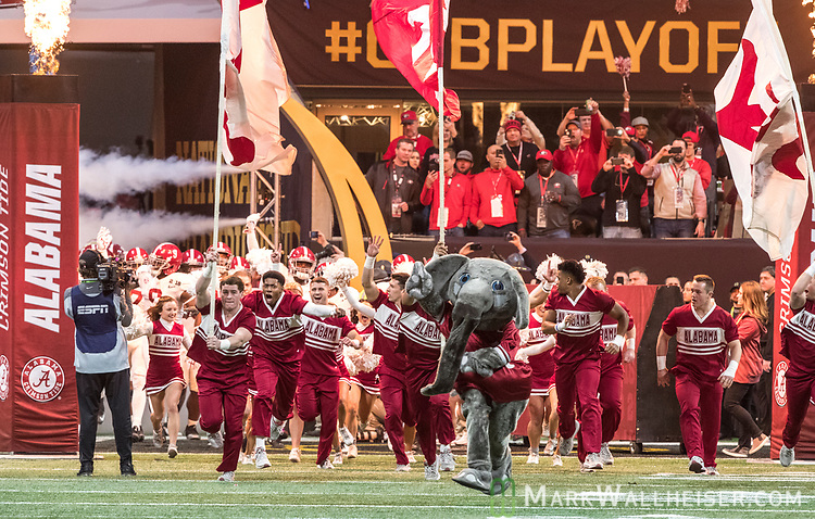 The Alabama Crimson Tide takes the field against the Georgia Bulldogs in the NCAA College Football Playoff National Championship at Mercedes-Benz Stadium on January 8, 2018 in Atlanta. Alabama defeated Georgia 26-23 in overtime.  Photo by Mark Wallheiser/UPI