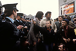 "Catholic youth gives the two finger salute the ""V"" sign to members of the RUC. (Royal Ulster Constabulary) The Troubles Belfast, Northern Ireland. 1980s."