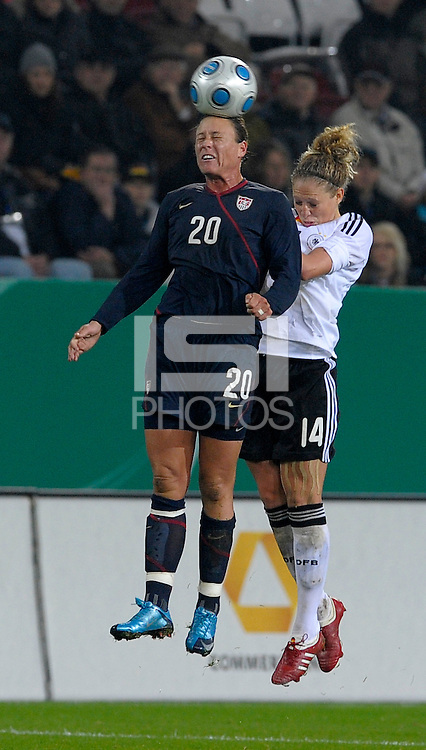 Abby Wambach heads the ball over Kim Kulig. US Women's National Team defeated Germany 1-0 at Impuls Arena in Augsburg, Germany on October 29, 2009.