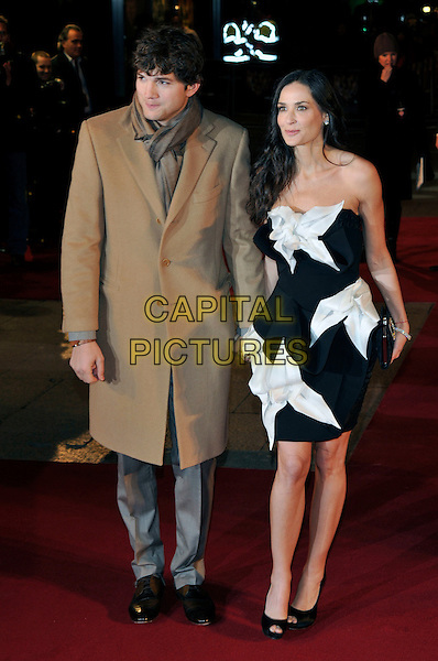 ASHTON KUTCHER, DEMI MOORE.'Valentine's Day' European film premiere at Odeon cinema, Leicester Square, London, UK, 11th February 2010..arrivals full length coat tan brown scarf camel coat grey gray trousers strapless black and white dress peep toe shoes married couple husband wife clutch bag holding hands .CAP/PL.©Phil Loftus/Capital Pictures