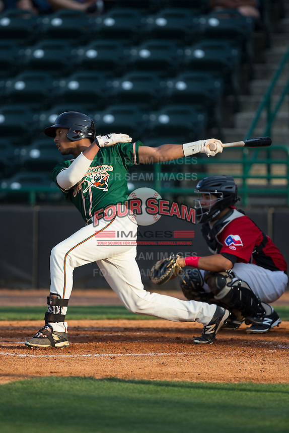 John Norwood (31) of the Greensboro Grasshoppers follows through on his swing against the Hickory Crawdads at L.P. Frans Stadium on May 6, 2015 in Hickory, North Carolina.  The Crawdads defeated the Grasshoppers 1-0.  (Brian Westerholt/Four Seam Images)