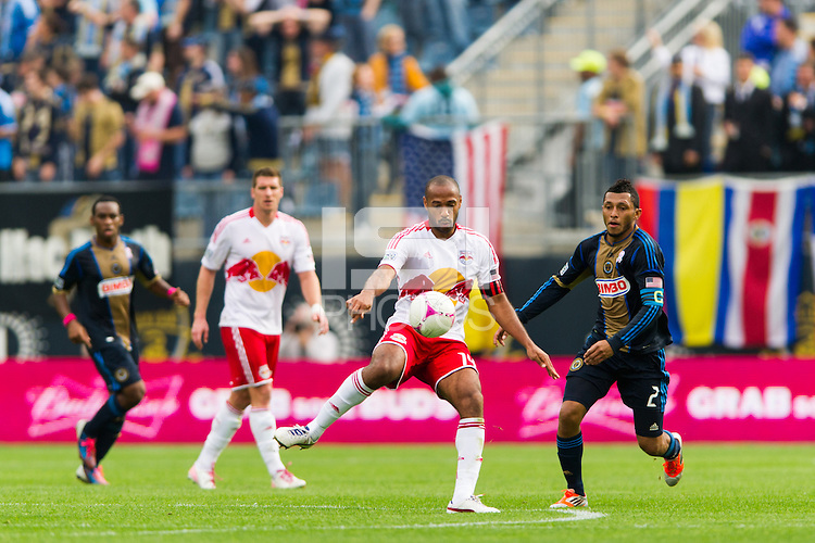 Thierry Henry (14) of the New York Red Bulls passes the ball during the first half against the Philadelphia Union during a Major League Soccer (MLS) match at PPL Park in Chester, PA, on October 27, 2012.