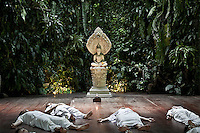 "A Thai female group performs a laying meditation as part of the Sathira Dhammasathan spiritual teaching program for the lay people. Vanished by centuries the lineage of ""Bhikkhu?nii"" (Order of Nuns) has been brought to the ongoing Thai society's debate. White-clad thai nuns, who keep the eight precepts and have their heads and eyebrows shaved are known as the lon-existing ""mae chees"" (low category to call the lay nuns). Females who have turned to religous life, as renunciants, live ostracized and marginalized by the Sangha (Buddhist community) and Thai society, denying them full access to the monastic life as well as rights and support from the government. Today nunhood is not recognized by any asian country belong to the Theravada Buddhist order. Most of the eight precept holders live in temples run by male abbots, at the shadow of the monks; with the exceptional existence of a few para-monastic institutions as the Sathira Dhammasathan meditation centre, where ""mae chees"" are not allow to held a temple, but not denied to practice the spiritual life."