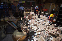 The rescue workers collecting and enumering the artefacts from the destroyed site of the Shoyembho temple, just outside Kathmandu, Nepal