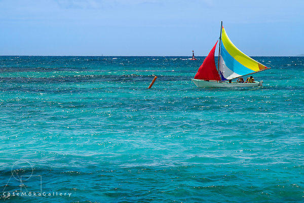 Children being taught water sports in the turquoise waters of St Anne Guadeloupe - sailing dinghy