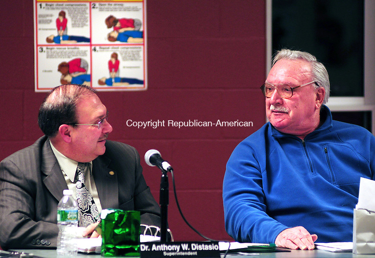 PLYMOUTH, CT, 12 DEC 12-121212AJ01- Patrick Perugino, right, Plymouth Board of Education Chairman, thanks Superintendent Anthony Distaso for his service to the public schools at Distasio's last meeting before retirement on Wednesday.  Alec Johnson/ Republican-American