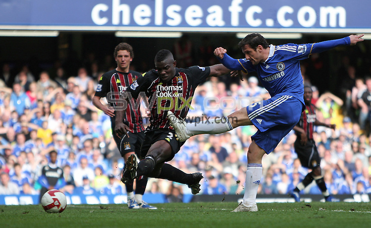 PICTURE BY JEREMY RATA/SWPIX.COM. Barclays Premier League 2008/9 - Chelsea v Manchester City, Stamford Bridge, London, England. 15th March 2009. Chelsea's Juliano Belletti shoots as Man City's Micah Richards tries in vain to stop it..Copyright - Simon Wilkinson - 07811267706