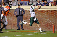 Oct 23, 2010; Charlottesville, VA, USA;  Eastern Michigan Eagles quarterback Alex Gillett (8) runs in for a touchdown in front of Virginia Cavaliers linebacker Darnell Carter (57) during the 1st half of the game at Scott Stadium.  Mandatory Credit: Andrew Shurtleff