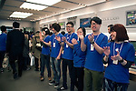 March 16, 2012, Tokyo, Japan - Staff from the Apple store in Ginza applaud the arrival of buyers. .Fans lined up overnight outside the Apple store in Ginza, to buy the new iPad. Japan was one of the first countries where Apple fans could get their hands on the new iPad.